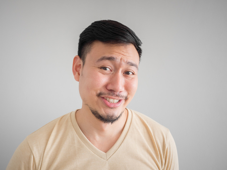 mislead: Headshot of funny guilty face of Asian man with beard and mustache.