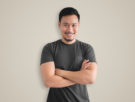Smiling face and confidence post of Asian man with beard.
