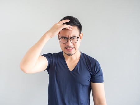 Mad Asian man with beard and eyeglasses.