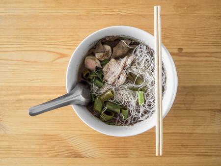 Thai Rice Vermicelli Pork Thicken Soup on wooden table. Stock Photo