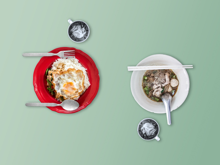 Rice topped with stir-fried pork basil and Thai white noodles in thicken soup. Stock Photo
