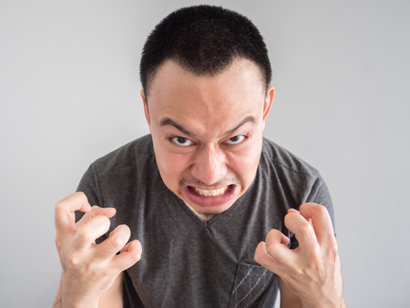 Angry asian man portrait with funny mad face. Stock Photo - 83756432