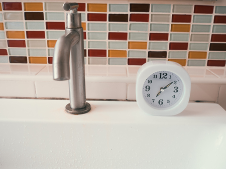 furniture design: Simple white clock in the bathroom. Concept of life routine. Stock Photo