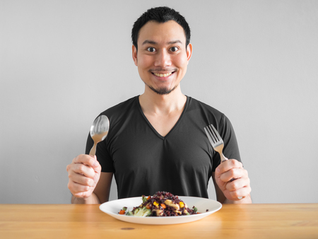 Asian man eats clean food for good healthy life. Reklamní fotografie