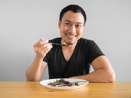 Asian man eats clean food for good healthy life. 스톡 콘텐츠