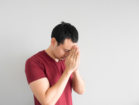 dhamma: Asian man paying respect or begging for forgiveness.