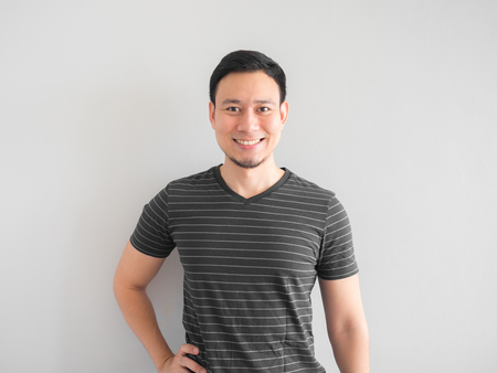 Smile and confident Asian man in black shirt.