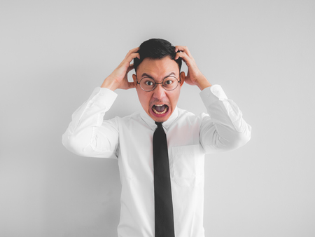 Angry Asian employee businessman in office uniform.