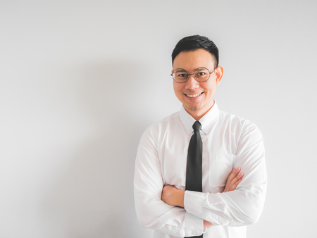 Happy Asian employee businessman in office uniform.