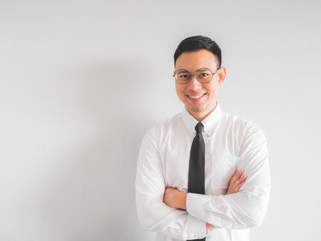 Happy Asian employee businessman in office uniform.