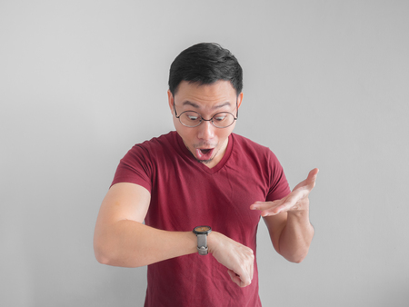 Happy and surprised Asian man who is looking at his watch. Stok Fotoğraf
