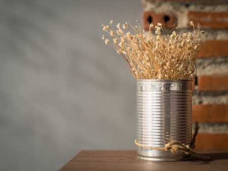 old desk: Flowering dried grass in aluminium pot for room decoration.