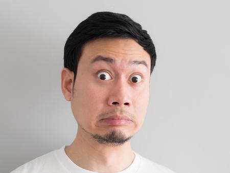 Shock face of Asian man head shot. 스톡 콘텐츠