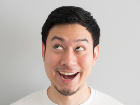 Wow face of Happy Asian man head shot. Archivio Fotografico