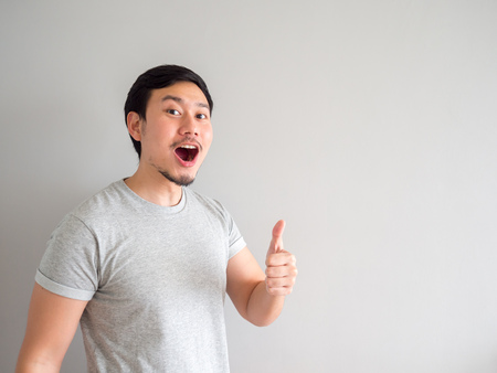 Asian man is feeling happy with his mouth breath and blowing.