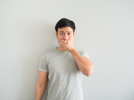 Funny face of bad breath Asian man. Stockfoto