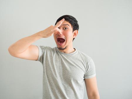 Funny face of bad breath Asian man. Stock Photo