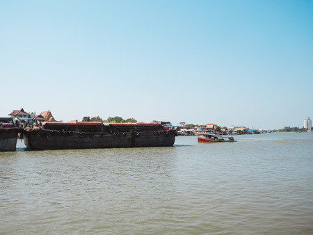 PAKKRED, NONTHABURI, THAILAND - APRIL 24, 2018: Empty barges are being push by towboat on Chao Phraya River.