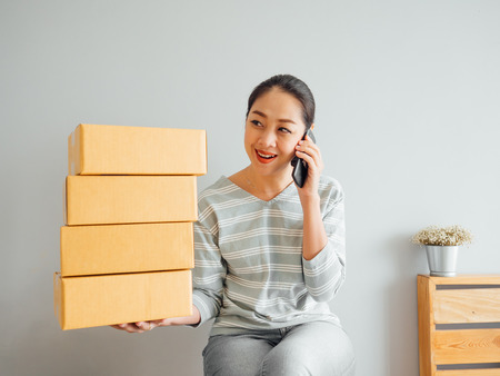Asian woman recieved big order of her online business via smartphone application.
