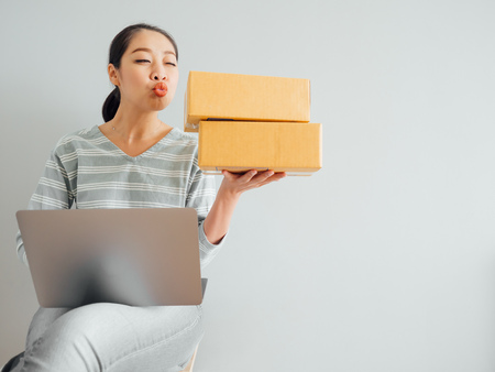 Concept of Asian woman happy with her online business sale.