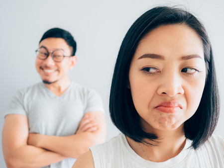 Annoyed Asian wife and funny tricky husband.