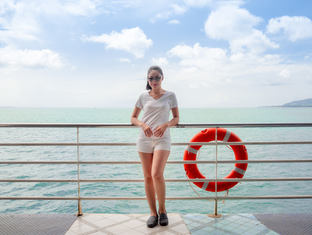 Asian tourist woman on the ferry is on the way for sea trip.