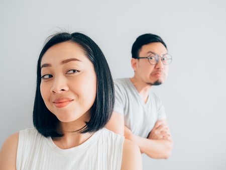 Happy tricky Asian wife and the angry loser husband.