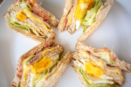 Closeup of breakfast set of club sandwiches.