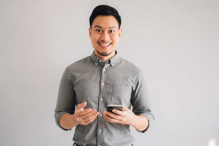 Happy and wow face of Asian man use smartphone. Stok Fotoğraf