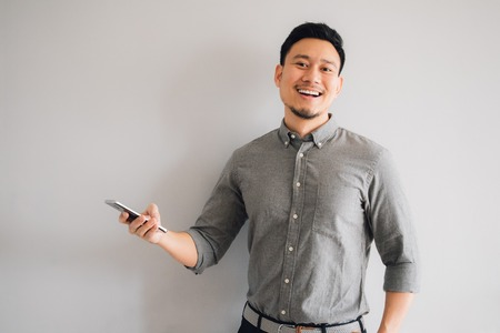 Happy and wow face of Asian man use smartphone. Stock Photo