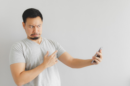 Asian man feels hate and disgusted with what show on the smartphone. Stock Photo