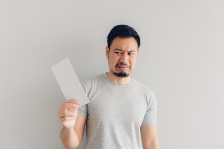 Asian man is hate and sad the white mail message or the bill. Imagens