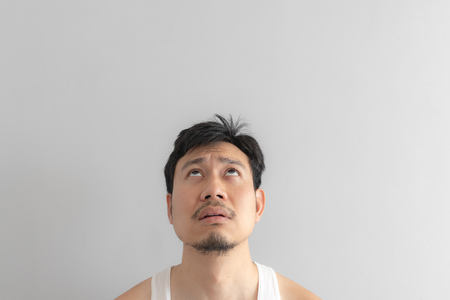 Lazy and messy Asian man in white tank top. Concept of poor and problem.