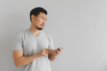 Asian man cry and sad with what show on the smartphone. Stock fotó