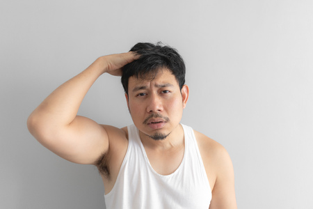 Lazy and messy Asian man in white tank top. Concept of poor and problem. Stock Photo
