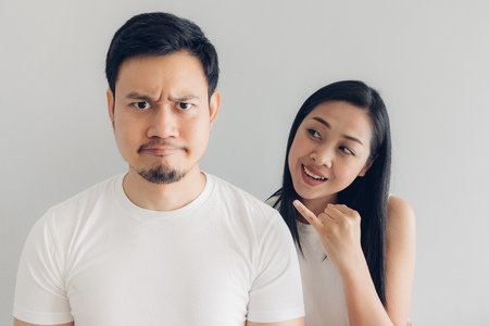 Sulk and reconcile Asian couple lover in white t-shirt and grey background. Stock Photo - 124606269