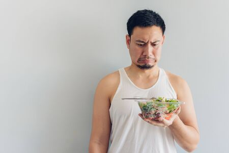 Asian man hates healthy salad meal. Archivio Fotografico