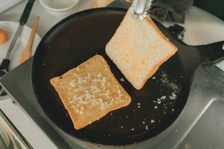 Close up of making recipe of Garlic breads in the kitchen. Stockfoto