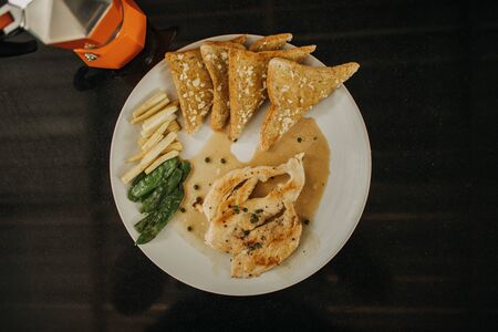Set of chicken breast steak with garlic breads and french fries and beans. Stockfoto