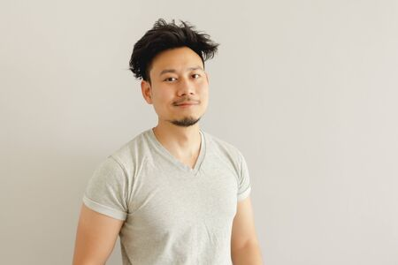 Portrait of Asian man with funny wake up hair style.
