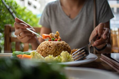 Woman is eating Thai Fried Rice with Shrimp paste