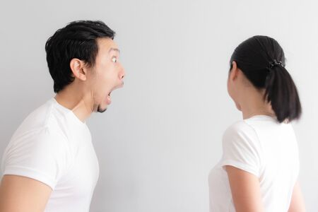 Asian funny face couple lover with bad breath problem.