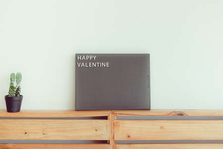 Announce pegboard with text Happy Valentine in concept of love and Valentine.