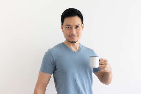 Happy smile face of Asian man drinks coffee on isolated background.
