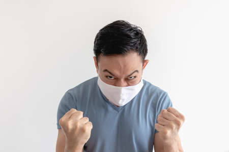 Angry and mad Asian man in face mask on isolated white background. 写真素材