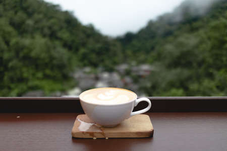 Coffee cup at small village in deep valley in Mae Kampong, Chiangmai, Thailand.