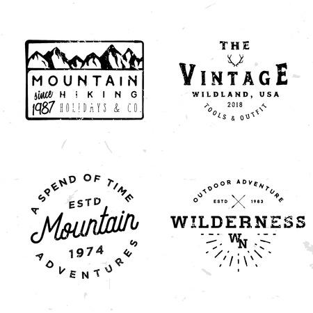 Bundle of wilderness badges, logos, design elements (mountain shapes, arrows, deer antlers). Vintage retro styled stock vector illustration