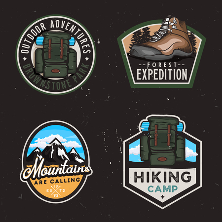 Travel badges and stickers with hike themed design elemets: hiking climbing shoe, travel backpack, mountain shapes. Dark background version