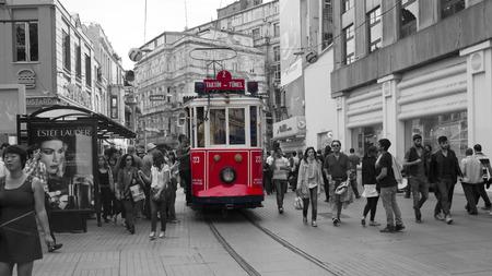 old tram and crowd in Istiklal Caddesi, Taksim, Turkey