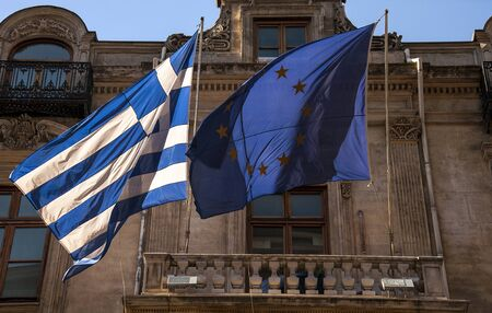 eec: Greek and European Union flags side by side